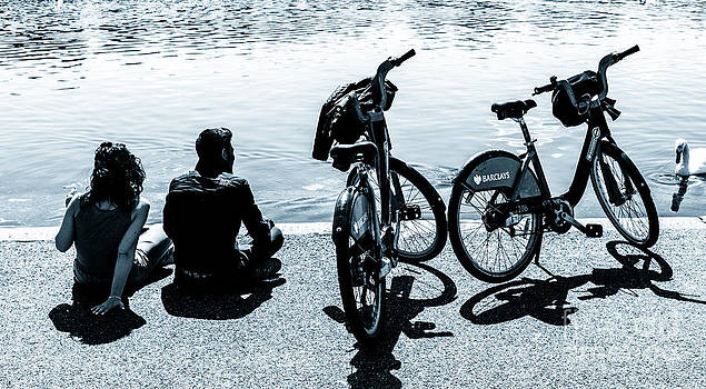 Peter Noyce - Couple with Barclays London Cycle Hire bicycles resting by the S