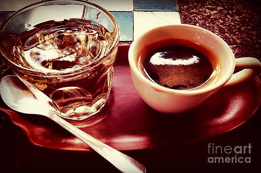 Cup of coffee on a wooden table by Keerati Preechanugoon