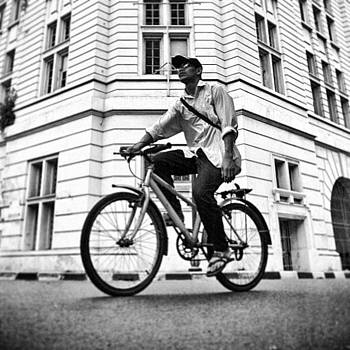 Cycling #bw #streetphotography by Dani Daniar
