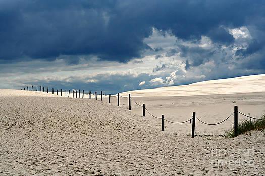Dark Clouds And Bright Sand by Ste Flei