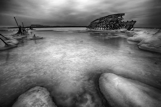 Darkness descends on the boat skeleton  by Jakub Sisak