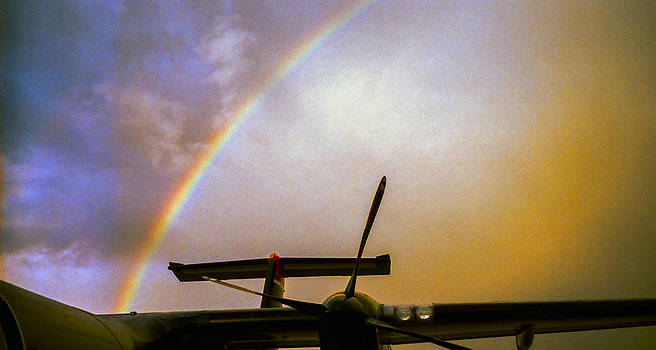 Dash 8 and Rainbow by Greg Reed