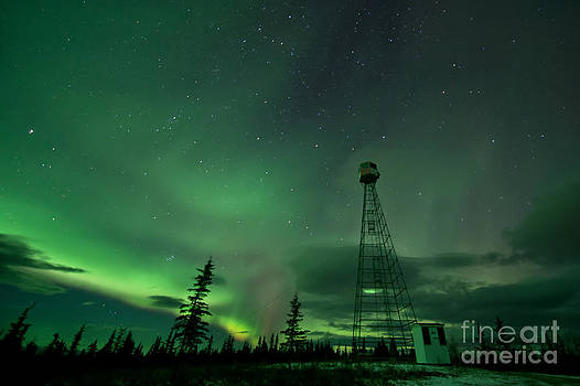 Dawson City Fire lookout Tower with Northern Lights by Priska Wettstein