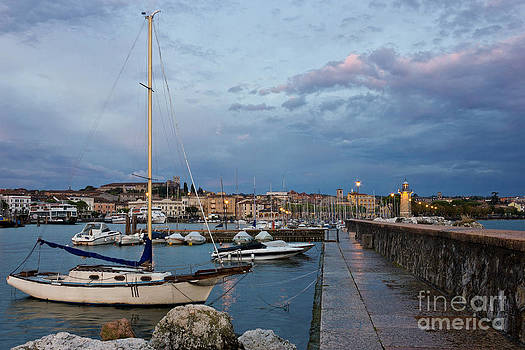 Desenzano del Garda view toward marina and city by Kiril Stanchev