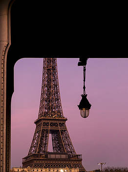 Detail of the Eiffel Tower Visible from Under a Bridge by Francesco Rizzato