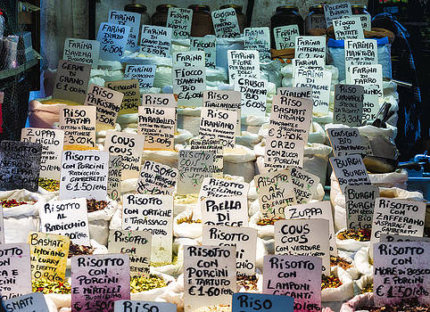Different Sorts of Rice and Spices on Display at a Local  by Francesco Rizzato