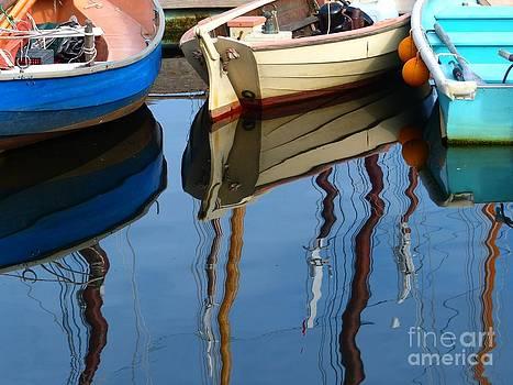 Christine Stack - Dingies with Reflection of Windjammer Schooner Masts in Camden Maine