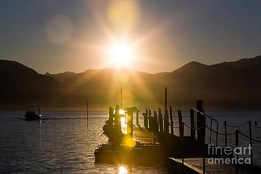 Docking at sunset by Maurizio Bacciarini