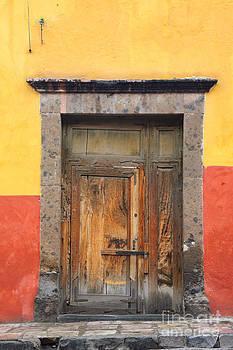 Oscar Gutierrez - Door in Yellow and Orange Wall