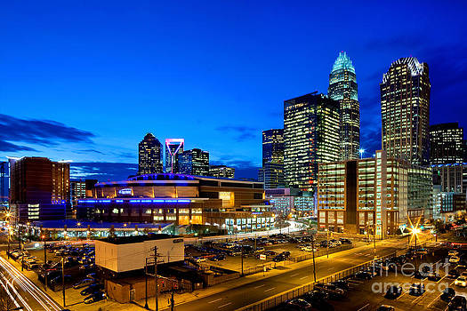 Downtown Charlotte skyline with blue sky at dusk by Patrick Schneider