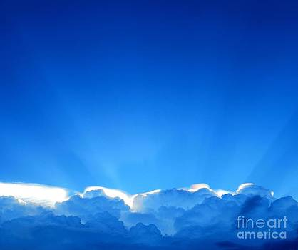 Dramatic scenes of sunbeams over blue sky by Pornthat Pornphanrat