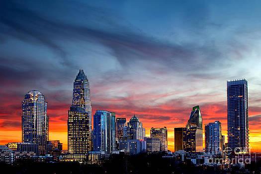Dramatic sunset against Charlotte skyline by Patrick Schneider