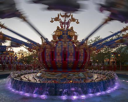 Adam Romanowicz - Dumbo the Flying Elephant ride at dusk