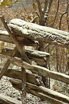 Valerie Kirkwood - Dusting of Snow on a Log Fence