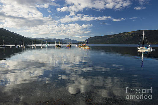 Early morning reflections on Loch Broom by Howard Kennedy