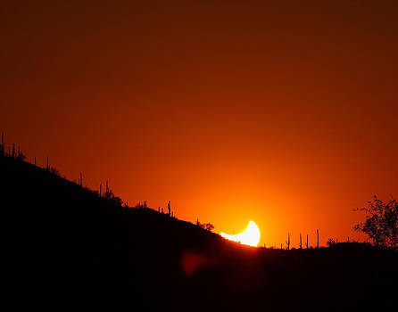 Eclipse sunset over the Tucson Mountains by Old Pueblo Photography