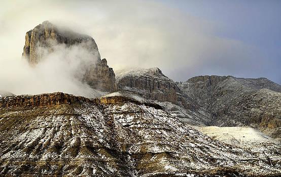 El Capitan emerging through the clouds by John Dickinson