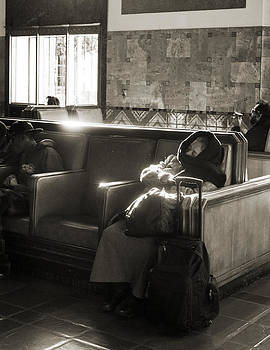Elderly woman wearing a scarf sleeping in Union station Los Ange by Kim M Smith
