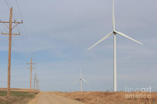 Electric Windmill's on a Country Road in Kansas by Robert D  Brozek