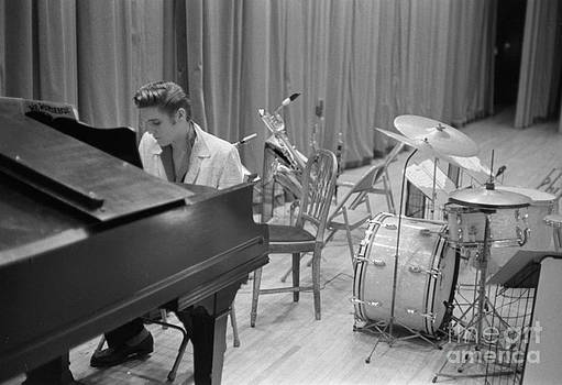 The Harrington Collection - Elvis Presley on piano waiting for a show to start 1956