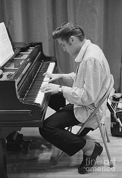 The Harrington Collection - Elvis Presley on piano while waiting for a show to start 1956