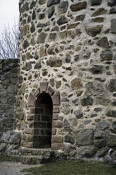 Entrance of a old tower by Patrick Kessler