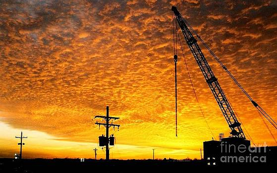 Erecting A Sunset In Beaumont Texas by Michael Hoard