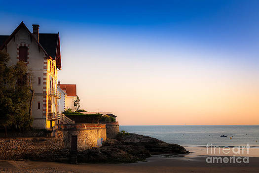 Evening sun on a house on the beach at Conche de Saint Palais ne by Peter Noyce