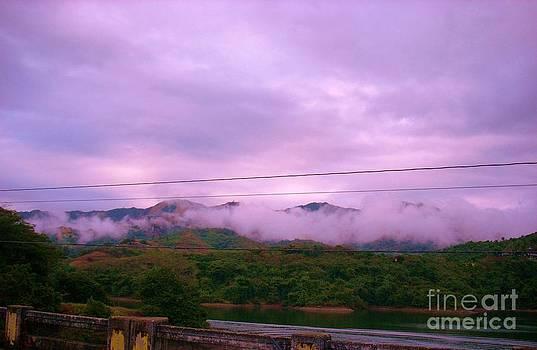 Falling Clouds by Iris  Mora