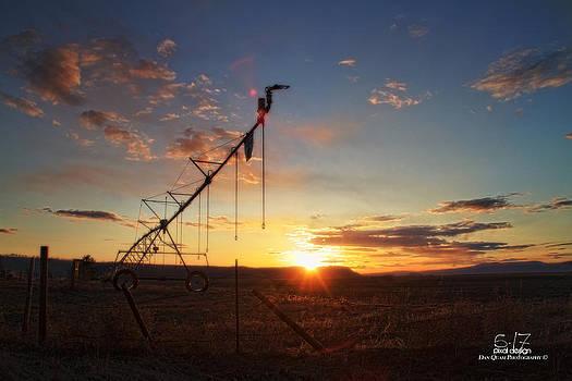 Farmer field sunset by Dan Quam