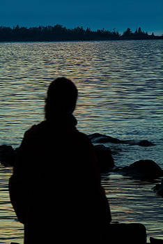 Devinder Sangha - Female Silhouette at lake