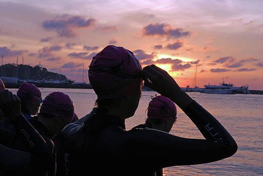 Female Triathletes At Sunrise by Nano Calvo