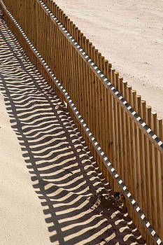 Fence on a Beach in Portugal by Chris  Clark