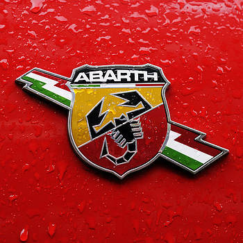 Fiat Abarth Badge On Red by Norman Pogson