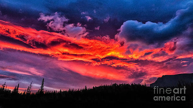 Fiery Sunrise at Glacier National Park by Sophie Doell