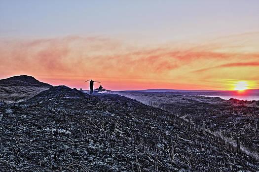 Firefighter at sunset by Tony Reddington