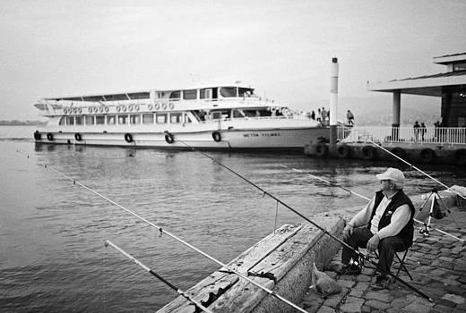 Fisherman at Alsancak by Ilker Goksen