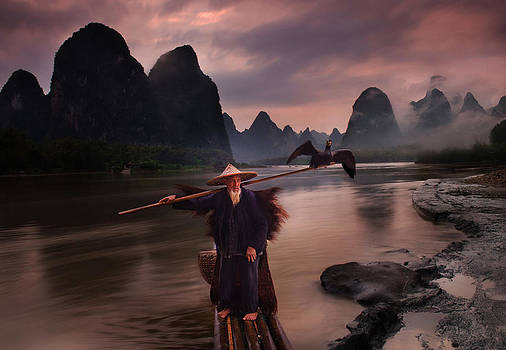 Fisherman at Li River by Weerapong Chaipuck