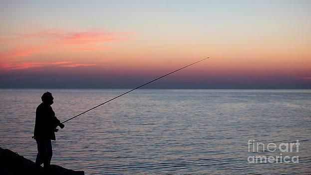 Fisherman at sunrise by Maurizio Bacciarini