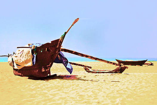 Kantilal Patel - fishermans catamarans beached in Tropics