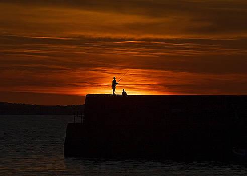 Fishing as sunset by Tony Reddington