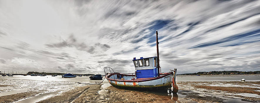Fishing Boat at low tide by Adrian Brockwell