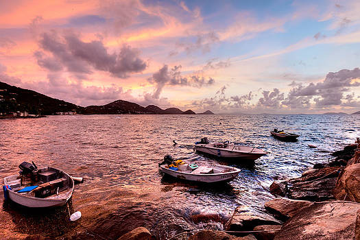 Fishing boats at a firey sunset by Anya Brewley Schultheiss