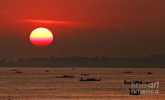Fishing boats at sunrise by Jojie Alcantara