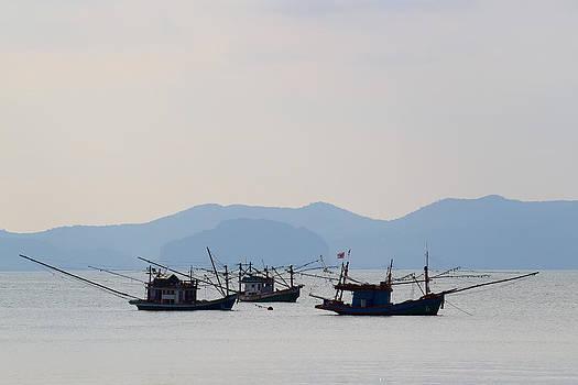 Fishing boats at sunset by Johan Elzenga