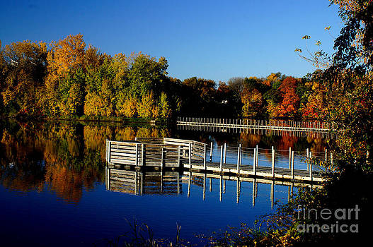Fishing Pier Refection In The Fall by Tina Hailey