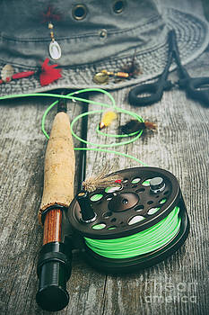 Sandra Cunningham - Fly fishing reel with old hat on bench