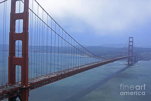 Fog Lifting Over The Golden Bridge  by Tina Hailey