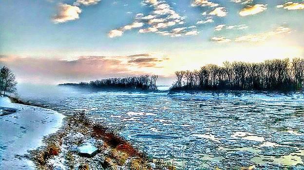 foggy morning on Missouri river. by Dustin Soph
