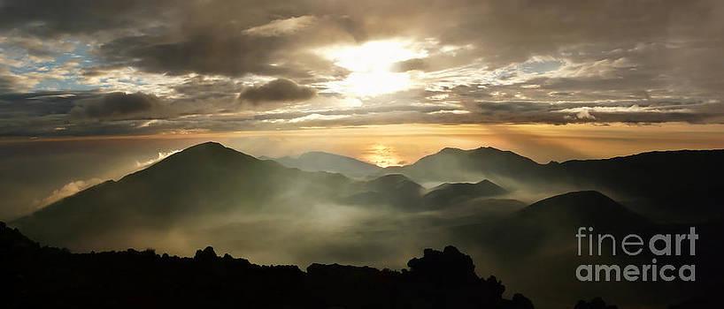 Foggy sunrise over Haleakala crater on Maui island in Hawaii by IPics Photography